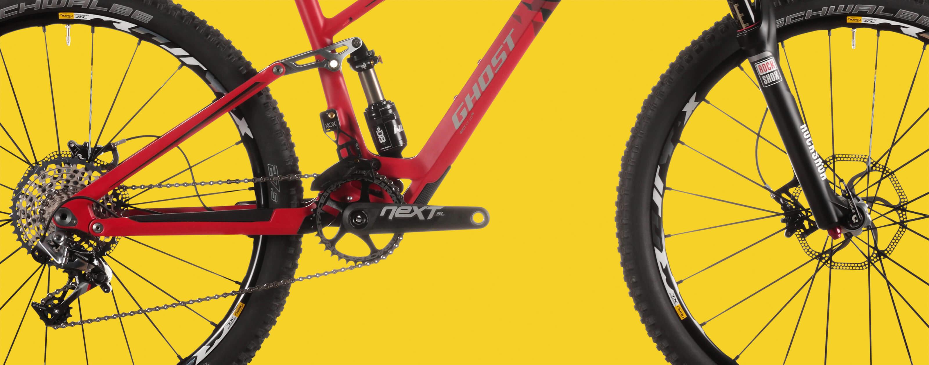 Fahrrad Ghost gelber Hintergrund Speichen Räder